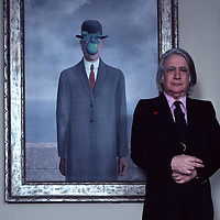 "Harry Torczyner, Magritte's attorney and model stands in front of Magritte painting of man with apple given to him by the artist in exchange for legal services.  Published in ""Connoisseur Magazine"", December 1982. Taken with a 35 mm Nikon FM."