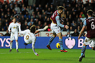 Swansea's Michu has an overhead kick at goal blocked by Villa's Chris Herd. Barclays Premier league, Swansea city v Aston Villa at the Liberty Stadium in Swansea, South Wales on New Years Day, Tuesday 1st Jan 2013. pic by Andrew Orchard, Andrew Orchard sports photography,