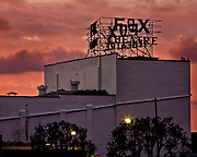Sunset lights up the clouds behind the Fox Theatre Sign. Silhouette. Fullerton, Califronia.