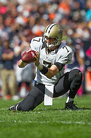 06 October 2013: Holder (7) Luke McCown of the New Orleans Saints receives the snap for a field goal against the Chicago Bears during the first half of the Saints 26-18 victory over the Bears in an NFL Game at Soldier Field in Chicago, IL.