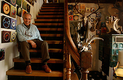 KNOKKE, BELGIUM - JULY-28-2005 - Roger Nellens is surrounded by a few pieces of his extensive art collection at his villa in Knokke-Zoute. (Photo © Jock Fistick)
