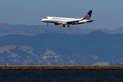 Embraer ERJ-175LR (N124SY) operated by SkyWest Airlines for United Express landing at San Francisco International Airport (KSFO), San Francisco, California, United States of America