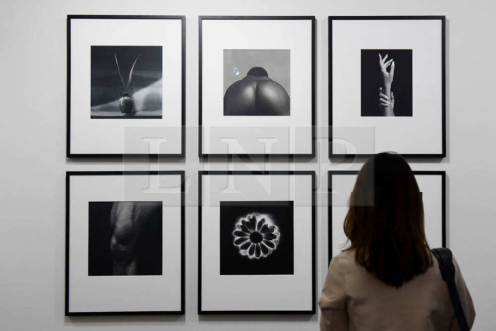 London, UK.  17 May 2017. A visitor views works by Robert Mapplethorpe.  Preview of Photo London 2017 at Somerset House.  Held for the third time, the event showcases the best in contemporary photography, from 89 galleries from 16 different countries, for collectors and enthusiasts and will be on from 18 - 21 May. Credit: Stephen Chung / Alamy Live News
