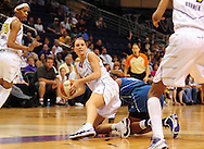 June 10, 2010; Phoenix, AZ, USA; Phoenix Mercury forward Penny Taylor grabs a loose ball during the first half in at US Airways Center.  Mandatory Credit: Jennifer Stewart-US PRESSWIRE