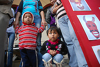 """MEXICO, Veracruz, Tantoyuca, Oct 27- Nov 4, 2009. Children watch """"Xantolo"""" dancers rehearse in Tantoyuca's """"Plaza Constitucion."""" """"Xantolo,"""" the Nahuatl word for """"Santos,"""" or holy, marks a week-long period during which the whole Huasteca region of northern Veracruz state prepares for """"Dia de los Muertos,"""" the Day of the Dead. For children on the nights of October 31st and adults on November 1st, there is costumed dancing in the streets, and a carnival atmosphere, while Mexican families also honor the yearly return of the souls of their relatives at home and in the graveyards, with flower-bedecked altars and the foods their loved ones preferred in life. Photographs for HOY by Jay Dunn."""