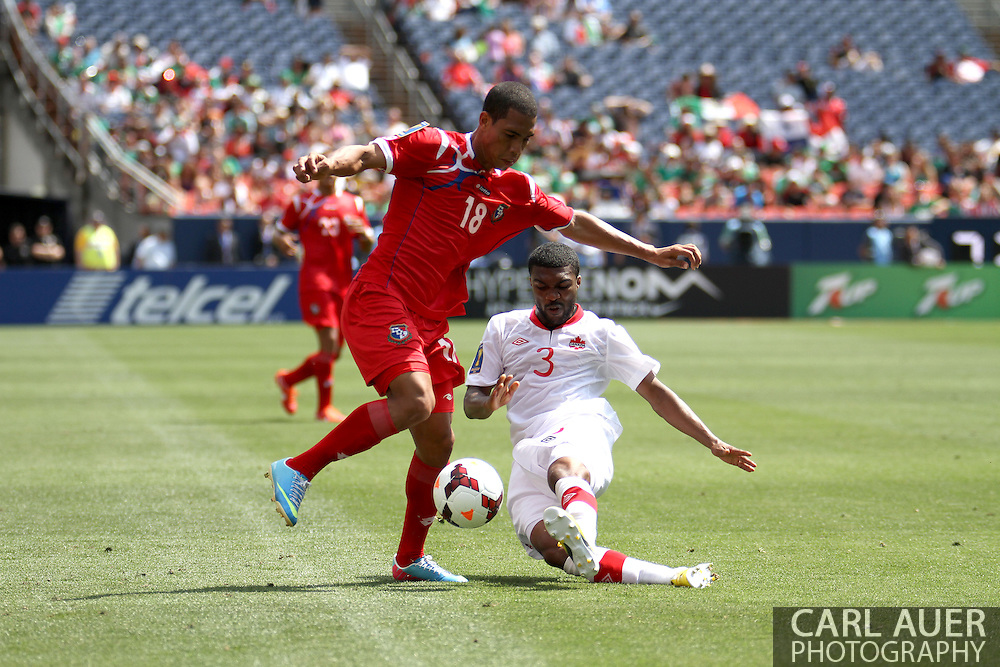 July 14 2013:  Panama Midfield Jairo Jimenez (18) attempts to avoid the tackle by Canada Defender Ashtone Morgan (3) during the second half of the CONCACAF Gold Cup soccer match between Panama and Canada at Sports Authority Field in Denver, CO. USA.