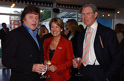 Left to right, RUPERT ALLASON and BILL CASH MP and his wife BIDDY at a party hosted by Sonia & Andrew Sinclair at The Westminster Boating Base, 136 Grosvenor Road, London SW1 on 5th June 2006.<br />