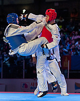 Burnaby, Canada. 19 November, 2016. WTF World Taekwondo Junior Championships Zachary Hiebert  (CAN) and Seung-Min Lee  (IRI) red compete in the semi final of male 73kg won by Lee. Photo: Peter Llewellyn