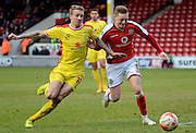 Walsall's Sam Mantom tussles with MK Dons Carl Baker during the Sky Bet League 1 match between Walsall and Milton Keynes Dons at the Banks's Stadium, Walsall, England on 14 March 2015. Photo by Alan Franklin.