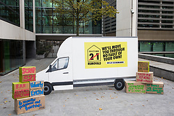 London, UK. 8 October, 2019. Props including a replica of a removal van brought by campaigners from Generation Rent UK and London Renters Union to a protest outside the Ministry of Housing, Communities and Local Government against renters being evicted under 1988 Housing Act law which allows landlords to kick out tenants without a reason. The Government is scheduled to debate ending this part of the law on 12th October. Credit: Mark Kerrison/Alamy Live News