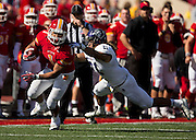 Angel Lopez (21) of the Abilene Christian Wildcats reaches out to tackle Jeff Seybold, Jr. (1) of the Pittsburg State Gorillas during Saturday's football game at Carnie Smith Stadium on October 5, 2013 in Pittsburg, Kansas. (David Welker)