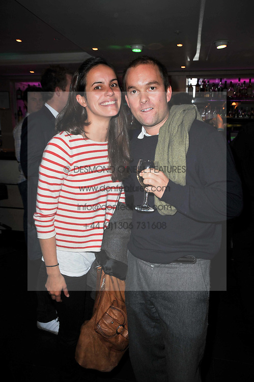 OLIVER CHITTENDEN and his fiancee EMILY CROFTON-ATKINS at a screening of the short film 'The Volunteer' held at the Courthouse Hilton Hotel, 19-21 Great Marlborough Street, London W1 on 26th October 2009.