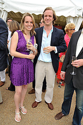 TOM KINGSTON and ANNABEL KILNER at a charity polo match organised by Jaeger Le Coultre was held at Ham Polo Club, Richmond, Surrey on 12th June 2009.