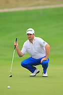 Graeme McDowell (NIR) on the 1st green during Saturay's Round 3 of the 2014 BMW Masters held at Lake Malaren, Shanghai, China. 1st November 2014.<br /> Picture: Eoin Clarke www.golffile.ie