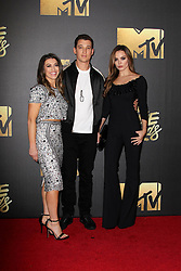 Miles Teller, Keleigh Sperry, Dana Teller, at the 2016 MTV Movie Awards, Warner Bros. Studios, Burbank, CA 04-09-16. EXPA Pictures © 2016, PhotoCredit: EXPA/ Photoshot/ Martin Sloan<br /> <br /> *****ATTENTION - for AUT, SLO, CRO, SRB, BIH, MAZ, SUI only*****