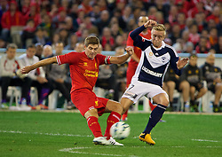 MELBOURNE, AUSTRALIA - Wednesday, July 24, 2013: Liverpool's captain Steven Gerrard in action against Melbourne Victory during a preseason friendly match at the Melbourne Cricket Ground. (Pic by David Rawcliffe/Propaganda)