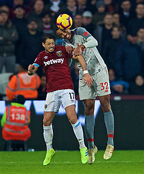 LONDON, ENGLAND - Monday, February 4, 2019: West Ham United's Javier Hernández 'Chicharito' (L) and Liverpool's Joel Matip (R) during the FA Premier League match between West Ham United FC and Liverpool FC at the London Stadium. (Pic by David Rawcliffe/Propaganda)