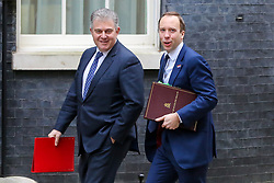© Licensed to London News Pictures. 15/01/2019. London, UK. Brandon Lewis - Tory party Chairman (L) and Matthew Hancock - Secretary of State for Health and Social care (R) arrives in Downing Street for the weekly Cabinet meeting. Later today, after five days of debate in the House of Commons, MPs will vote on the British Prime Minister Theresa May's EU Withdrawal deal. Photo credit: Dinendra Haria/LNP