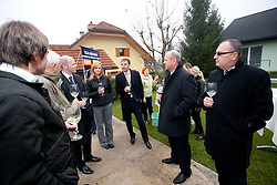 Visitors at opening ceremony of rebuilded T. Gregorin's house after she moved from Ihan, on November 10, 2011, in Hotemaze at Kranj, Slovenia. (Photo by Vid Ponikvar / Sportida)