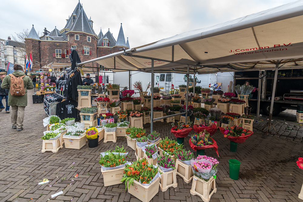 Flowers sit on the floor of the market in Amsterdam, Netherlands