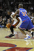 Feb 4, 2010; Cleveland, OH, USA; Miami Heat guard Dwyane Wade (3) drives around Cleveland Cavaliers forward Jawad Williams (31) during the second quarter at Quicken Loans Arena. Mandatory Credit: Jason Miller-US PRESSWIRE