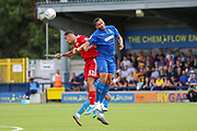 AFC Wimbledon defender Rod McDonald (4) winning header during the EFL Sky Bet League 1 match between AFC Wimbledon and Accrington Stanley at the Cherry Red Records Stadium, Kingston, England on 17 August 2019.