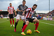 Lincoln City Defender Neal Eardley holds back Coventry City Midfielder Michael Doyle during the EFL Sky Bet League 2 match between Lincoln City and Coventry City at Sincil Bank, Lincoln, United Kingdom on 18 November 2017. Photo by Craig Zadoroznyj.