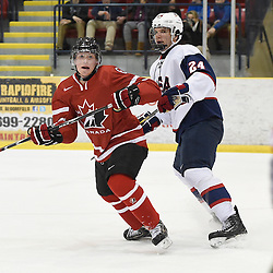 WELLINGTON, - Dec 11, 2015 -  Exhibition Game 2- Team USA vs Team Canada East at the 2015 World Junior A Challenge at the Wellington District Community Centre, ON. Derek Topatigh #6 of Team Canada East battles for controlwith William Knierem #24 of Team United States during the first period.<br /> (Photo: Andy Corneau / OJHL Images)