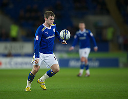 CARDIFF, WALES - Tuesday, February 14, 2012: Cardiff City's Aron Gunnarsson in action against Peterborough United during the Football League Championship match at the Cardiff City Stadium. (Pic by David Rawcliffe/Propaganda)