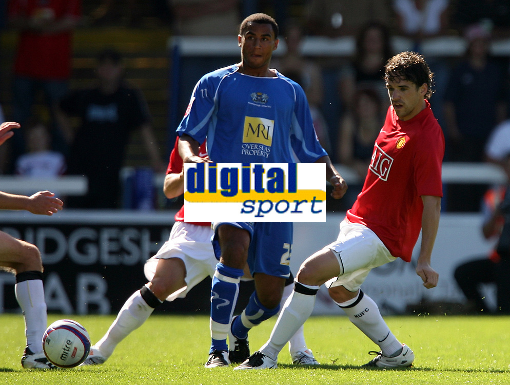 Photo: Paul Thomas.<br /> Peterborough United v Manchester United. Pre Season Friendly. 04/08/2007.<br /> <br /> New Utd signing Owen Hargreaves (R) puts pressure on goal scorer Rene Howe.