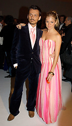 MATTHEW WILLIAMSON and SIENNA MILLER at the Moet & Chandon Fashion Tribute 2005 to Matthew Williamson, held at Old Billingsgate, City of London on 16th February 2005.<br />