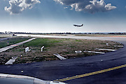 airplane landing seen from a taxiing and departing plane at Istanbul Ataturk Airport Turkey