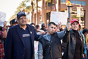 17 JANUARY 2011 - PHOENIX, AZ: BEN MIRANDA and his with CATHERINE MIRANDA accompany a torch bearer during the Martin Luther King march in Phoenix. Ben Miranda is a Democratic member of the Arizona Legislature. About 500 people participated the Martin Luther King Jr March through downtown Phoenix, Monday, Jan. 17. PHOTO BY JACK KURTZ