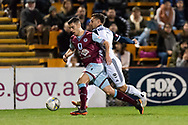 SYDNEY, AUSTRALIA - AUGUST 21: APIA Leichhardt Tigers defender Paul Galimi (3) and Melbourne Victory forward Kosta Barbarouses (9) go for the ball at the FFA Cup Round 16 soccer match between APIA Leichhardt Tigers FC and Melbourne Victory at Leichhardt Oval in Sydney on August 21, 2018. (Photo by Speed Media/Icon Sportswire)