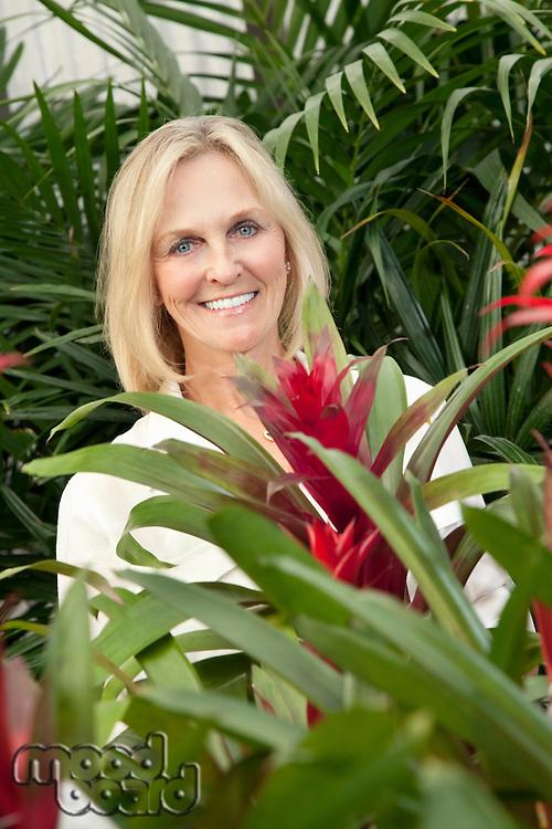 Portrait of a cheerful senior woman in garden center