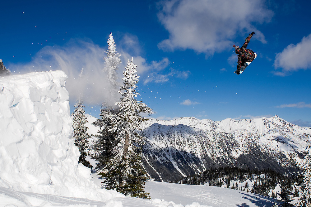 Professional snowboarder Romain de Marchi jumps in the backcountry around Whistler, BC.