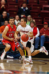 Nov 14, 2011; Stanford CA, USA;  Stanford Cardinal guard Aaron Bright (2) dribbles past Fresno State Bulldogs guard Steven Shepp (12) during the first half of a preseason NIT game at Maples Pavilion. Mandatory Credit: Jason O. Watson-US PRESSWIRE