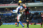 Chris Brown and Clint Hill battle during the Sky Bet Championship match between Blackburn Rovers and Queens Park Rangers at Ewood Park, Blackburn, England on 12 January 2016. Photo by Pete Burns.
