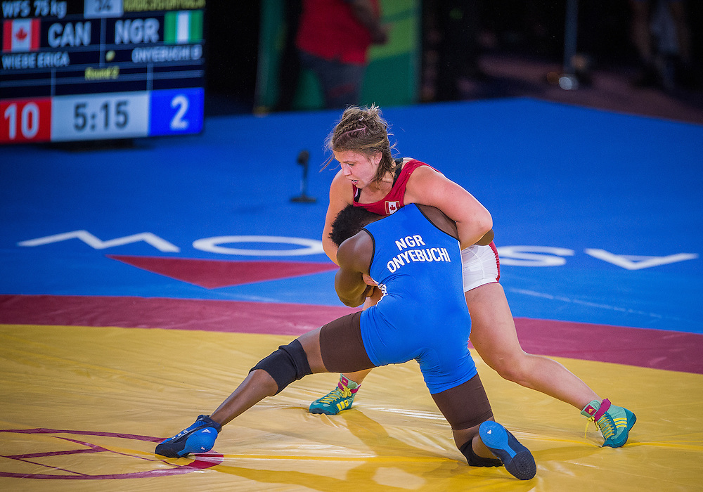 July 29, 2014: Erica Wiebe of Canada takes on Blessing Onyebuchi of Nigeria in the Women's 75kg Nordic Wrestling competition at the Scottish Exhibition Conference Centre during the XX Commonwealth Games in Glasgow, Scotland.