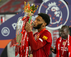 LIVERPOOL, ENGLAND - Wednesday, July 22, 2020: Liverpool's Joe Gomez kisses the Premier League trophy and his winners' medal as the Reds are crowned Champions after the FA Premier League match between Liverpool FC and Chelsea FC at Anfield. The game was played behind closed doors due to the UK government's social distancing laws during the Coronavirus COVID-19 Pandemic. (Pic by David Rawcliffe/Propaganda)