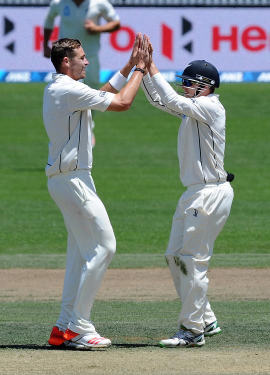 New Zealand's Tim Southee, left, celebrates with Tom Latham after bowling Sri Lanka's Rangara Herath for 0 on day three of the second International Cricket Test, Seddon Park, Hamilton, New Zealand, Sunday, December 20, 2015. Credit:SNPA / Ross Setford