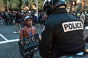 Michael Brown protest with Devonte Hart age 12 and police officer, Portland Oregon