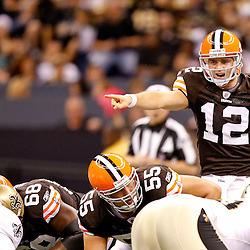 Oct 24, 2010; New Orleans, LA, USA; Cleveland Browns quarterback Colt McCoy (12) under center during a game against the New Orleans Saints at the Louisiana Superdome. The Browns defeated the Saints 30-17.  Mandatory Credit: Derick E. Hingle