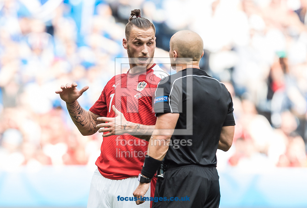 Marciniak Arnautovic of Austria chats with referee Szymon Marciniak during the UEFA Euro 2016 match at Stade Velodrome, Marseille, France.<br /> Picture by EXPA Pictures/Focus Images Ltd 07814482222<br /> 22/06/2016<br /> *** UK &amp; IRELAND ONLY ***<br /> EXPA-FEI-160622-5032.jpg