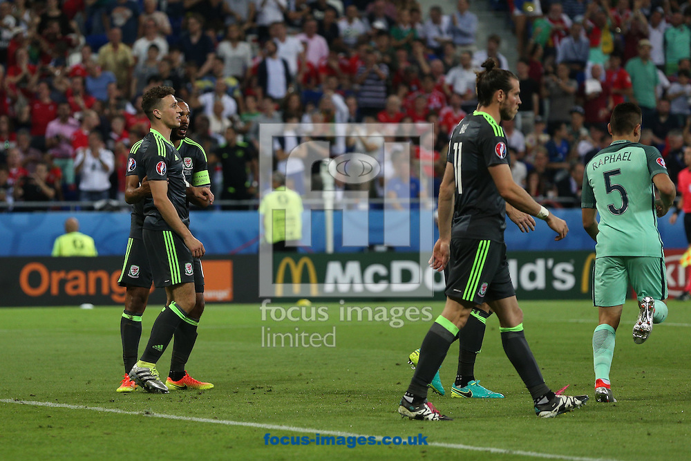 Ashley Williams of Wales, Neil Taylor of Wales and Gareth Bale of Wales look dejected after conceding their side&rsquo;s 1st goal during the UEFA Euro 2016 semi-final match at Stade de Lyons, Lyons<br /> Picture by Paul Chesterton/Focus Images Ltd +44 7904 640267<br /> 06/07/2016