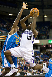November 29, 2009; Sacramento, CA, USA;  Sacramento Kings guard Tyreke Evans (13) jumps past New Orleans Hornets center Emeka Okafor (50) during the third quarter at the ARCO Arena.  Sacramento defeated New Orleans 112-96.