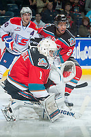 KELOWNA, CANADA - NOVEMBER 7: Jackson Whistle #1 and Devante Stephens #21 of Kelowna Rockets keep their eye on the puck against the Spokane Chiefs on November 7, 2014 at Prospera Place in Kelowna, British Columbia, Canada.  (Photo by Marissa Baecker/Shoot the Breeze)  *** Local Caption *** Devante Stephens; Jackson Whistle;
