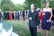 ALAIN DE BOTTON; CHARLOTTE DE BOTTON, 2009 Serpentine Gallery Summer party. Sponsored by Canvas TV. Serpentine Gallery Pavilion designed by Kazuyo Sejima and Ryue Nishizawa of SANAA. Kensington Gdns. London. 9 July 2009.