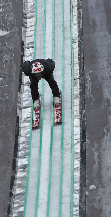 28.12.2013, Nordische Arena, Ramsau, AUT, OeSV Training, Nordische Kombination, im Bild Mario Stecher (AUT) waehrend des Skisprung-Anlauf-Trainings // Mario Stecher of Austria during a Trainingsession of Austrian Nordic Combined Team at the Nordic Arena in Ramsau, Austria on 2013/12/28, EXPA Pictures © 2013, PhotoCredit: EXPA/ Martin Huber