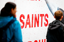 A general view of a 'Saints' sign as fans walk through an overpass leading to St Marys Stadium prior to kick off - Mandatory by-line: Ryan Hiscott/JMP - 12/08/2018 - FOOTBALL - St Mary's Stadium - Southampton, England - Southampton v Burnley - Premier League
